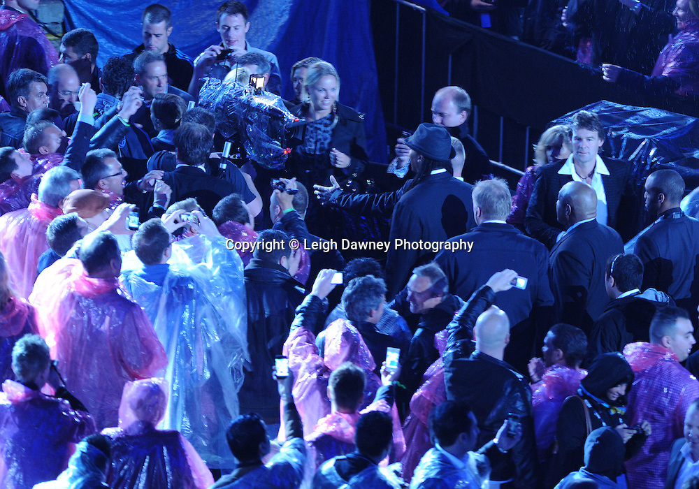 Lennox Lewis escorted through the crowd at the Wladimir Klitschko v David Haye fight for the WBO, WBA & IBF Heavyweight Title at Imtech Arena, Hamburg, Germany, 2nd July 2011. Photo credit: Leigh Dawney 2011