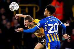 Ryan Bennett of Wolverhampton Wanderers beats Aaron Holloway of Shrewsbury Town to a header - Mandatory by-line: Robbie Stephenson/JMP - 05/02/2019 - FOOTBALL - Molineux - Wolverhampton, England - Wolverhampton Wanderers v Shrewsbury Town - Emirates FA Cup fourth round replay