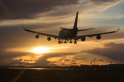 Heathrow Airport, London, March 28th 2016. A British Airways Boeing 747-400 lands as the sun illuminates the clouds left behind as departing Storm Katie drifts eastwards at London Heathrow.