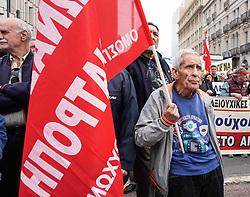 November 20, 2018 - Athens, Greece - A pensioner holds a flag as he takes part during a rally in Central Athens. Hundreds of pensioners took to  the streets as they demanding return of all the cuts they have suffered in their pensions during the crisis. (Credit Image: © Giannis Alexopoulos/NurPhoto via ZUMA Press)