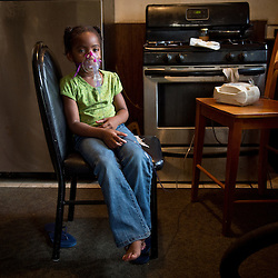 Siobhan Washington's granddaughter La'Miya, 5 uses a nebulizer. she suffers from Asthma in River Rouge, Detroit, near a DTE coal plant August 13, 2012.