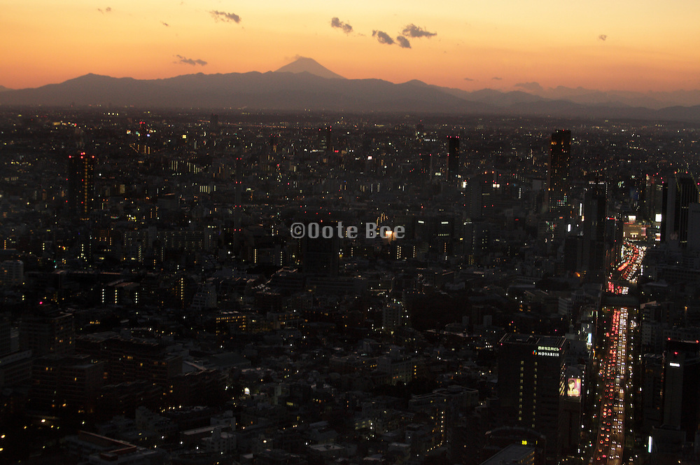 Mt Fuji from Roppongi tower with Tokyo City front at dusk
