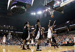 Virginia center Aisha Mohammed (33) grabs a rebound over Maryland guard Ashleigh Newman (21).  The Virginia Cavaliers women's basketball team fell to the #4 ranked Maryland Terrapins 74-62 at the John Paul Jones Arena in Charlottesville, VA on January 18, 2008.