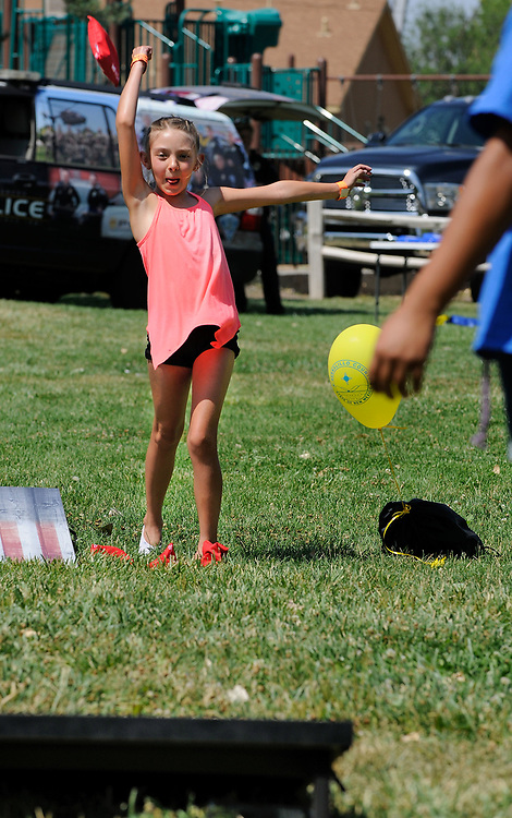 jt071417j/ a sec/jim thompson/ Taylor Sprague-8 tosses her bean bag while playing a game of Cornhole at Rotary Park in Bernalillo,NM.  Friday,  July. 14, 2017. (Jim Thompson/Albuquerque Journal)