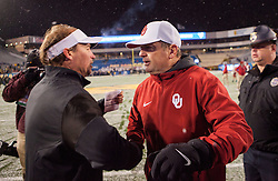 Nov 19, 2016; Morgantown, WV, USA; Oklahoma Sooners head coach Bob Stoops speaks with West Virginia Mountaineers head coach Dana Holgorsen after beating the West Virginia Mountaineers at Milan Puskar Stadium. Mandatory Credit: Ben Queen-USA TODAY Sports
