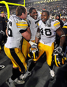 Oct 24, 2009; East Lansing, MI, USA; Iowa FB Brett Morse (36) wide receiver Marvin McNutt (7) and linebacker Troy Johnson (48) celebrate after beating the Spartans 15-13 at Spartan Stadium. The Hawkeyes beat the Spartans 15-13. Mandatory Credit: Jason Miller-US PRESSWIRE