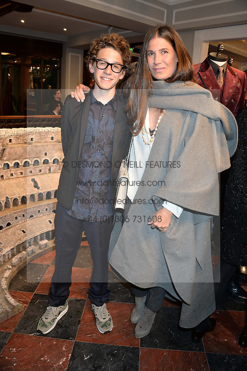 ELIZABETH SALTZMAN and her son HARRY WALKER at the Dolce & Gabbana London Collections: Mens Event 2014 held at Dolce & Gabbana, 53-55 New Bond Street, London on 5th January 2014.