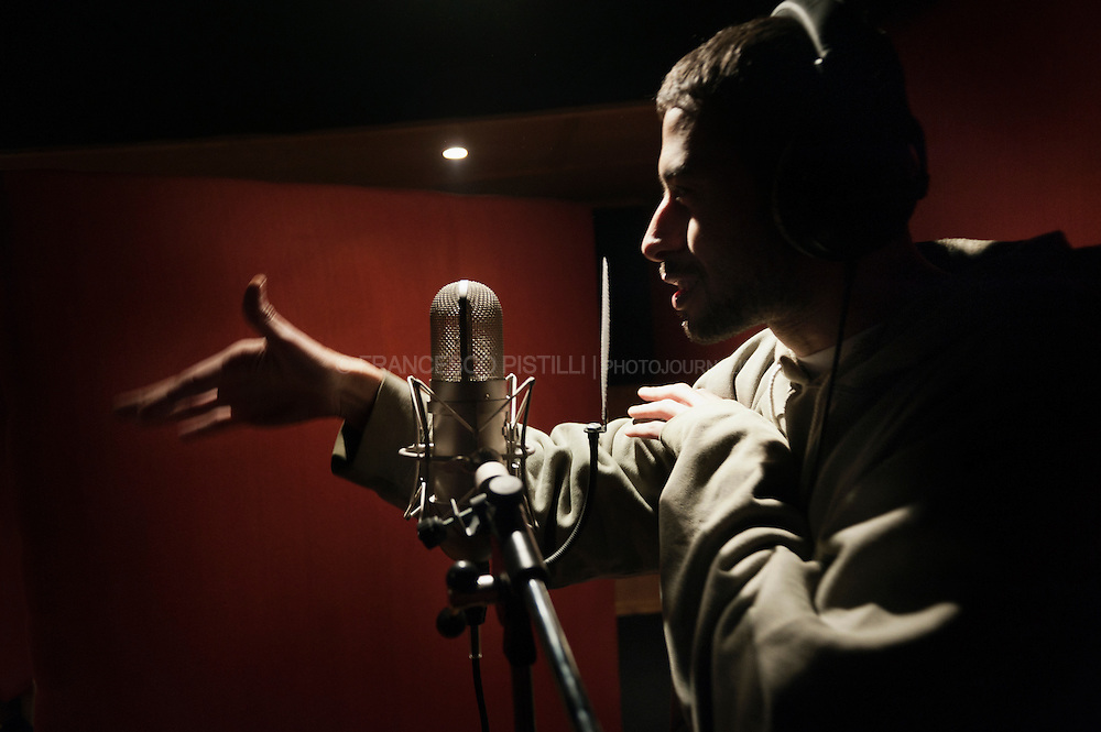 "December 11, Cairo 2011. Egypt. Mc Rush from ""Arabian Knightz"": the biggest Middle-east HipHop Crew, based in Cairo, Egypt. Rush during a recording session at Arab League Records, Cairo."
