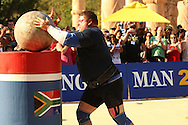 Defending champion Zydrunas Savickas (Lithuania) places the final Atlas Stone on the platform in his head-to-head with Brian Shaw (UK) during the final rounds of the World's Strongest Man competition held in Sun City, South Africa.