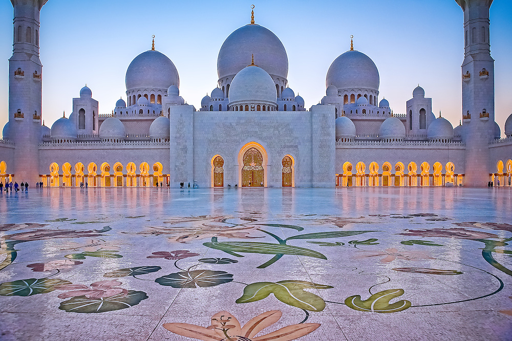 A frontal view of grand terrace taken from below the main entrance arch of Sheikh Zayed Mosque in Abu Dhabi at Maghreb Prayers