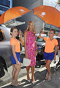IMAGE DISTRIBUTED FOR ACCUWEATHER -  Beth Ostrosky Stern is shaded from the hot summer sun by the AccuWeather MinuteCast street team at New York Fashion Week, on Tuesday, Sept. 15, 2015. The AccuWeather MinuteCast Street Team is at it again helping Fashion Week attendees stay stylish and one-step ahead of any possible precipitation. (Photo by Diane Bondareff/Invision for AccuWeather/AP Images)