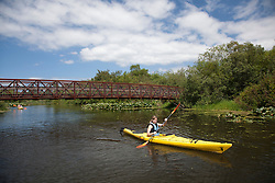 North America, United States, Washington, Bellevue, girl (age 12) kayaking in Mercer Slough Nature Park.  MR