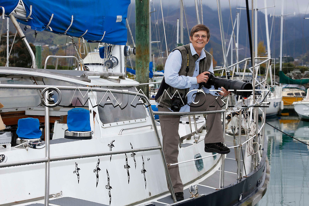 Tui DeRoy, wildlife photographer, on her expedition yacht Mahalia, Nelson Marina, New Zealand