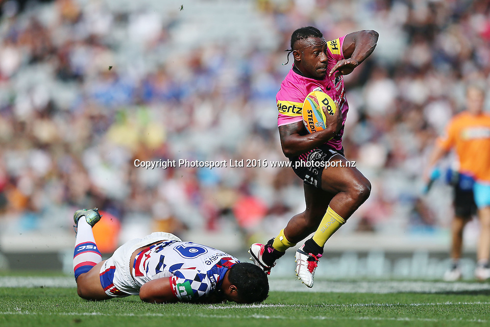 James Segeyaro of the Panthers beats the tackle from Pat Mata'utia of the Knights during Day 1 of the NRL Auckland Nines Rugby League Tournament, Eden Park, Auckland, New Zealand. Saturday 6 February 2016. Photo: Anthony Au-Yeung / www.photosport.nz