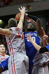 02 January 2013:  Gregory Echenique goes up hard with a shot defended by Jordan Threloff during an NCAA Missouri Vally Conference (MVC) mens basketball game between the Creighton University Bluejays and the Illinois State Redbirds in Redbird Arena, Normal IL