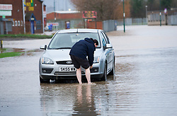 © Licensed to London News Pictures. 27/11/2012..Teesside, England..Following a further night of heavy rain parts of Teesside remain underwater and is causing road closures and localised flooding.A woman break down on an industrial estate on Teesside...Photo credit : Ian Forsyth/LNP