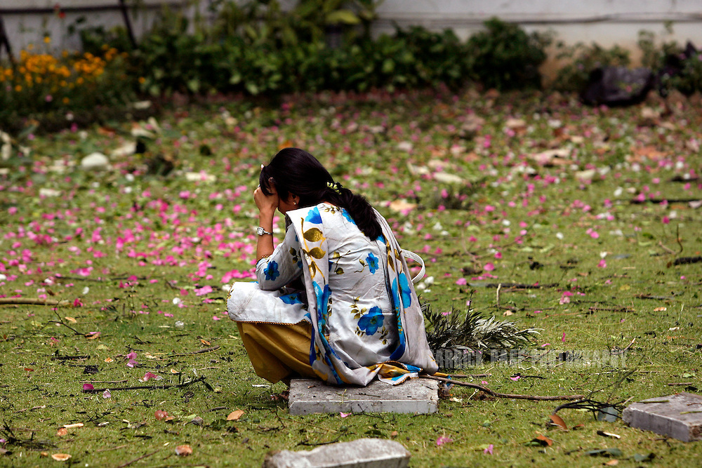 ISLAMABAD, PAKISTAN - JUNE 2: A Danish Embassy staff member sits in shock after an explosion outside the Danish Embassy on Monday, June 2, 2008 in Islamabad, Pakistan. A suspected car bomb exploded outside the embassy at  midday, killing at least 8 people and wounding more than a dozen according to reports. Militant Islamic groups have threatened Danish embassies around the world with retribution for the publications of cartoons depicting the prophet Mohammed, first printed in September 2005. (Photo by Warrick Page)
