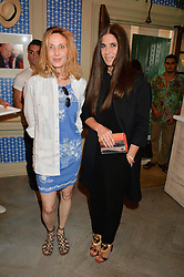 Left to right, ANDA ROWLAND and ELIZABETH SALTZMAN at the launch of the new collection from Limoland held at Anderson & Sheppard's Haberdashery, 17 Clifford Street,London on 16th June 2014.