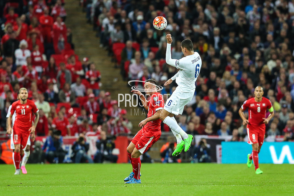 England's Chris Smalling heads clear during the UEFA European 2016 Qualifying match between England and Switzerland at Wembley Stadium, London, England on 8 September 2015. Photo by Shane Healey.