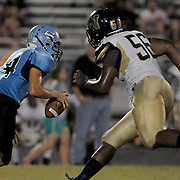 North Brunswick High School's Jabril Robinson attempts to tackle South Brunswick High School's Cole Blackburn Friday September 13, 2013. (Jason A. Frizzelle)