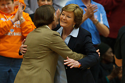 Dec 20, 2011; Stanford CA, USA;  Tennessee Lady Volunteers head coach Pat Summitt (right) hugs Stanford Cardinal head coach Tara VanDerveer (left) before the game at Maples Pavilion.  Stanford defeated Tennessee 97-80. Mandatory Credit: Jason O. Watson-US PRESSWIRE