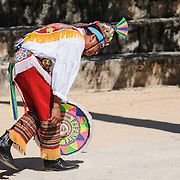 A dancer in traditional costume performing a Maya dance at Xcarat Maya theme park south of Cancun and Playa del Carmen on Mexico's Yucatana Peninsula.