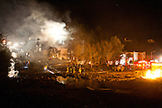 SAN BRUNO, CA - SEPTEMBER 9: A crater filled with water marks the site of an explosion that caused a fire September 9, 2010 in a San Bruno, California residential street. A massive explosion rocked a neighborhood near San Francisco International Airport.
