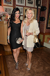 Left to right, Canadian politician DR RUBY DHALA and LIZ BREWER at a party to celebrate 35 years of Harry's Bar, 26 South Audley Street, London on 19th September 2014.