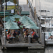 Restaurants accessible either by boat or car offer al fresco dining by the Intracoastal Waterway in South Florida.  Photography by Jose More
