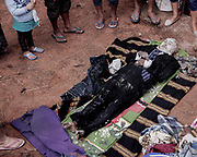 The body of Markus Tombang who died in 2016 at age 64 is taken out by family members for cleaning and grooming.<br /> <br /> Ma'nene is a tradition that takes place in August after harvest where the bodies of the dead loved ones are exhumed to be cleaned, groomed and dressed. For most, it's a bittersweet moment, a chance to reunite and physically see and touch and reconnect with loved ones who had passed on.