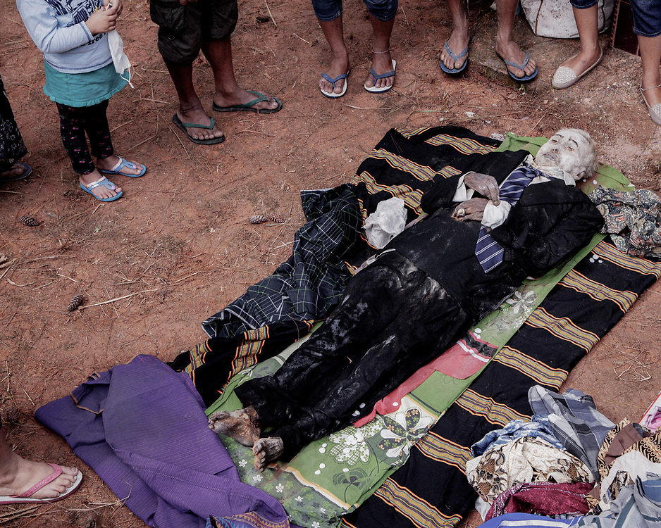 The body of Markus Tombang who died in 2016 at age 64 is taken out by family members for cleaning and grooming.<br />
