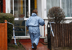 © Licensed to London News Pictures. 04/04/2013, London, UK.  A forensic officer enters the house in Croydon, South London where a 67 year old man died after being taken ill after he arrived back home, Wednesday, to find his home was burgled, Thursday, April 4, 2013. Photo credit : Sang Tan/LNP