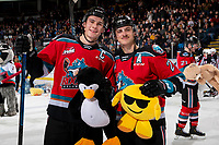 KELOWNA, BC - NOVEMBER 30: Nolan Foote #29 and Leif Mattson #28 of the Kelowna Rockets pose with teddy bears after scoring a first period goal against the Prince George Cougars at Prospera Place on November 30, 2019 in Kelowna, Canada. (Photo by Marissa Baecker/Shoot the Breeze)