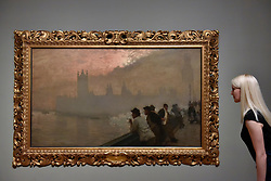 "© Licensed to London News Pictures. 30/10/2017. London, UK.  A staff member views ""Westminster"", 1878, by Giuseppe de Nittis at a preview of ""Impressionists in London, French Artists in Exile (1870-1904)"" at Tate Britain.  The exhibition brings together over 100 works by Monet, Tissot, Pissarro and others in the first scale show of French artists who sought refuge in Britain during the Franco-Prussian War and shows views of London as seen through French eyes.  The exhibition runs 2 November 2017 to 29 April 2018.  Photo credit: Stephen Chung/LNP"