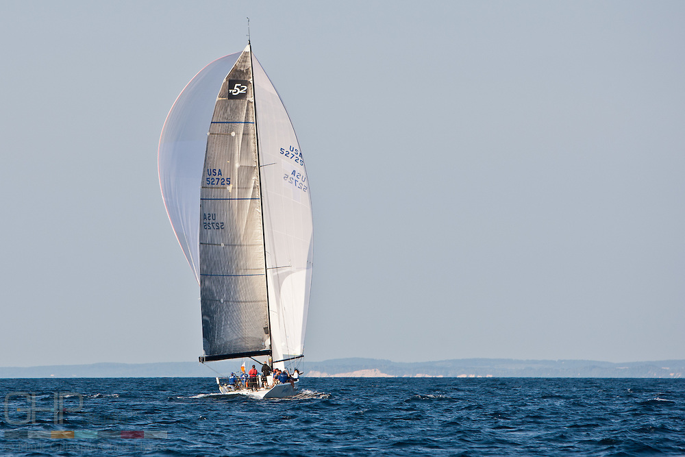 Imedi, USA 52725,  a Transpac 52, sails under her huge spinnaker though the Manitou Passage.