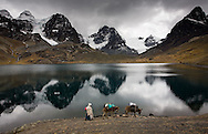 Lake Chiar Khota sits below Mt. Condoriri and provides water for the people that use this basecamp for climbing.  A cholita follows her burros into basecamp after a three-hour trek in the Cordillera Real, Bolivia.