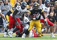September 19, 2009: Iowa running back Adam Robinson (32) during the Iowa Hawkeyes' 27-17 win over the Arizona Wildcats at Kinnick Stadium in Iowa City, Iowa on September 19, 2009.