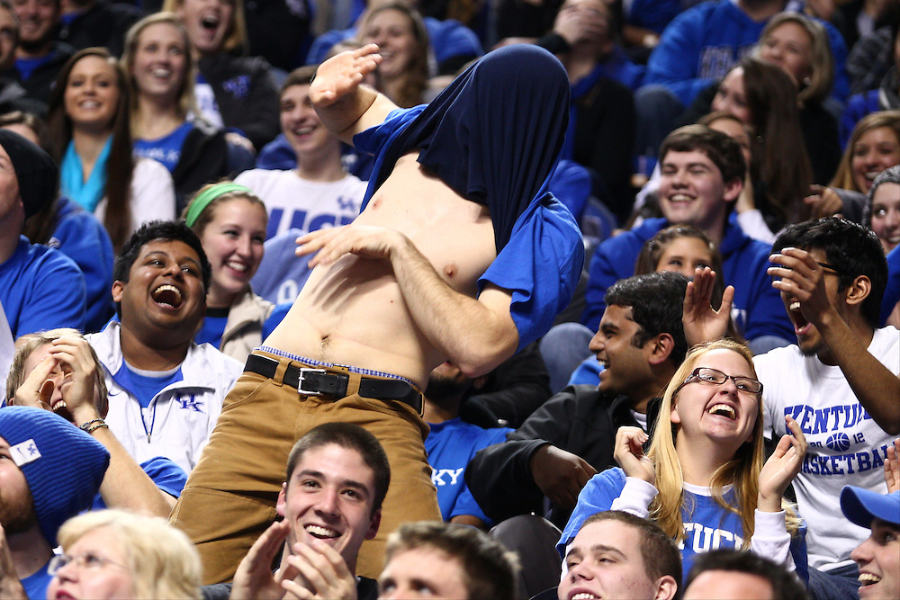 Fans show excitement during a timeout when the TV cameras pan the building for wacky dancing. The University of Kentucky Men's Basketball team hosted University of Tennessee , Tuesday, Jan. 15, 2013 at Rupp Arena in Lexington . Photo by Jonathan Palmer/Special to the Courier-Journal