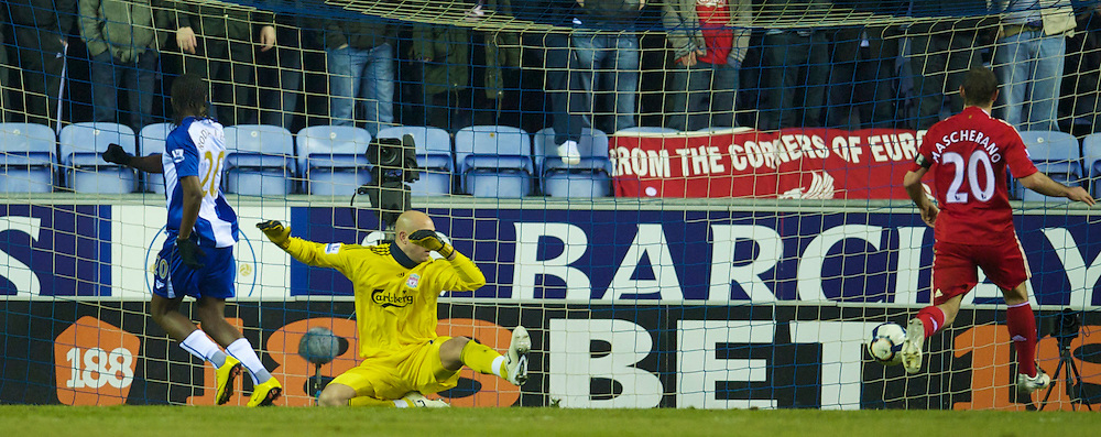 WIGAN, ENGLAND - Monday, March 8, 2010: Liverpool's goalkeeper Pepe Reina looks dejected as Wigan Athletic's Hugo Rodallega scores the opening goal during the Premiership match at the DW Stadium. (Photo by David Rawcliffe/Propaganda)