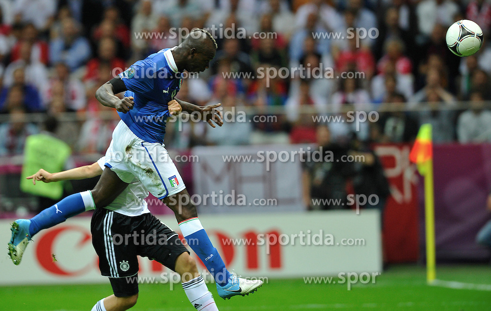 Warsaw 29/06/2012.POLAND, WARSAW .Italy's Mario Balotelli scores the first goal during the Euro 2012 football championships semi-final match Italy vs Germany, on June 28, 2012 at the National Stadium in Warsaw. .Photo by: Piotr Hawalej / WROFOTO