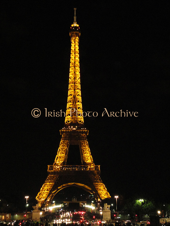 The Eiffel Tower located on the Champ de Mars in Paris. Built in 1889, it has become both a global icon of France and one of the most recognizable structures in the world. Named for its designer, engineer Gustave Eiffel, the tower was built as the entrance arch to the 1889 World's Fair. The tower stands 324 metres (1,063 ft.) tall, about the same height as an 81-story building. Upon its completion, it surpassed the Washington Monument to assume the title of tallest man-made structure in the world, a title it held for 41 years, until the Chrysler Building in New York City was built in 1930;