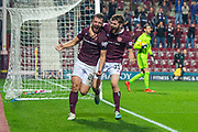 Craig Halkett (#26) of Heart of Midlothian FC runs to celebrate after he scores the equalising goal in injury time during the Betfred Scottish Football League Cup quarter final match between Heart of Midlothian FC and Aberdeen FC at Tynecastle Stadium, Edinburgh, Scotland on 25 September 2019.