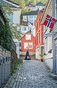 A woman dressed in traditional garb walks down a street in Bergen during the celebration of Syttende Mai, Norway's Constitution Day, celebrated on May 17th.