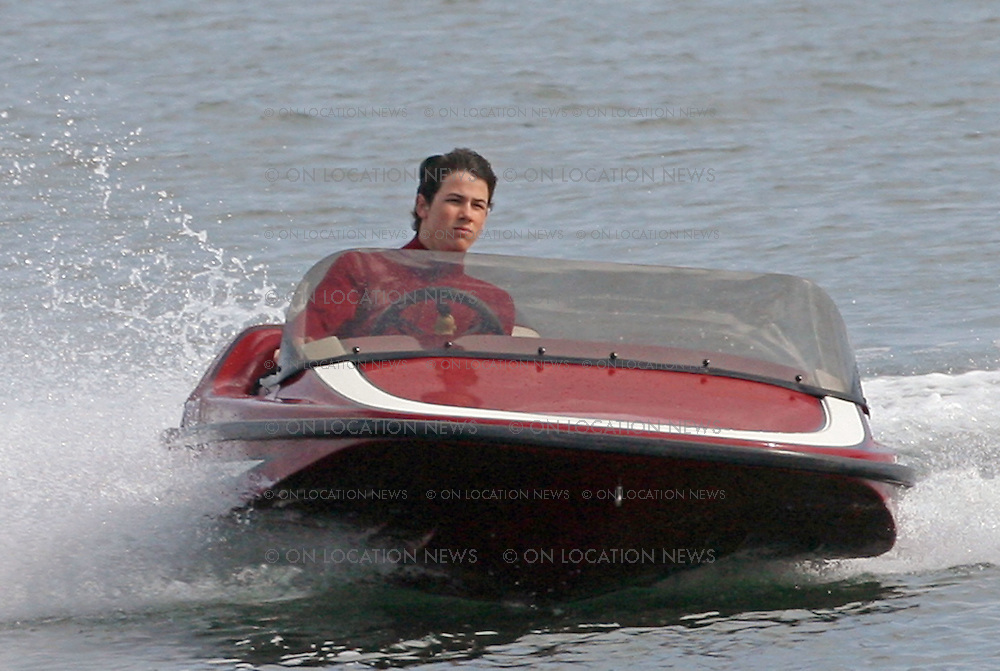 SAN PEDRO, CALIFORNIA - THURSDAY 22nd MAY 2008 EXCLUSIVE: The Jonas Brothers filming a video for their new single 'Kung-Fu Grip'. The Brothers dressed in a number of outfits for the video including Kung-Fu costumes. Nick dressed in a red wet suit while sailing a speedboat then jumped out and fired a net gun at two guys. Photograph: On Location News. Sales: Eric Ford 1/818-613-3955 info@onlocationnews.com