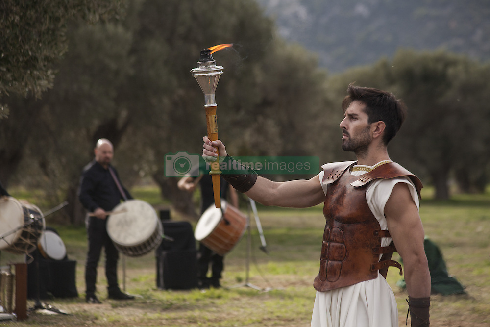 November 12, 2016 - Marathonas, Greece - Day Runner lights the torch with the Marathon flame. Ceremony in the Greek city of Marathonas as part of the 35 Athens Marathon the Authentic. (Credit Image: © George Panagakis/Pacific Press via ZUMA Wire)