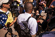 17 AUGUST 2009 -- PHOENIX, AZ: Phoenix resident Christopher Broughton carried a military style AR-15 type rifle during the rally opposed to Obama. About 5,000 people were expected to demonstrate in favor of President Obama's health care proposals. Nearly 1,500 showed up to demonstrate against the President.  PHOTO BY JACK KURTZ
