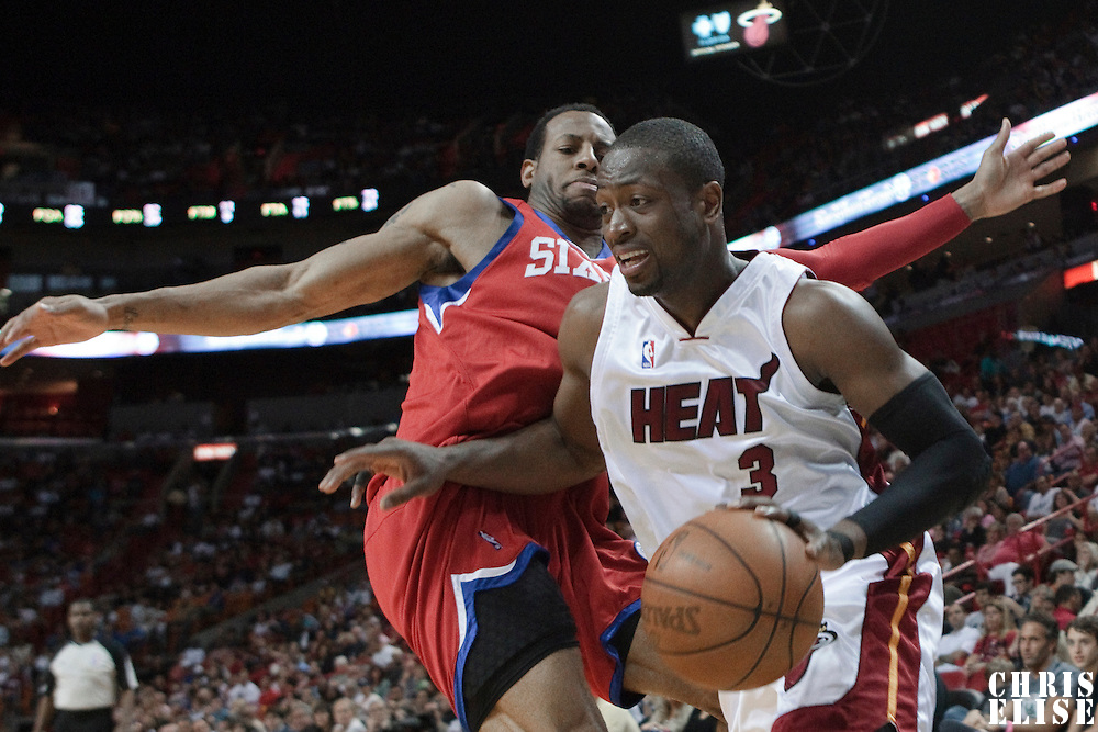 14 March 2010: Miami Heat guard Dwyane Wade drives past Philadelphia 76ers guard Andre Iguodala during the Miami Heat 100-89 victory over the Philadelphia 76ers at the AmericanAirlines  Arena, in Miami, Florida, USA.