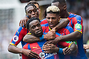 Jeffrey Schlupp (15) of Crystal Palace, celebrates after scoring goal, Patrick van Aanholt (3) of Crystal Palace during the Premier League match between Fulham and Crystal Palace at Craven Cottage, London, England on 11 August 2018.