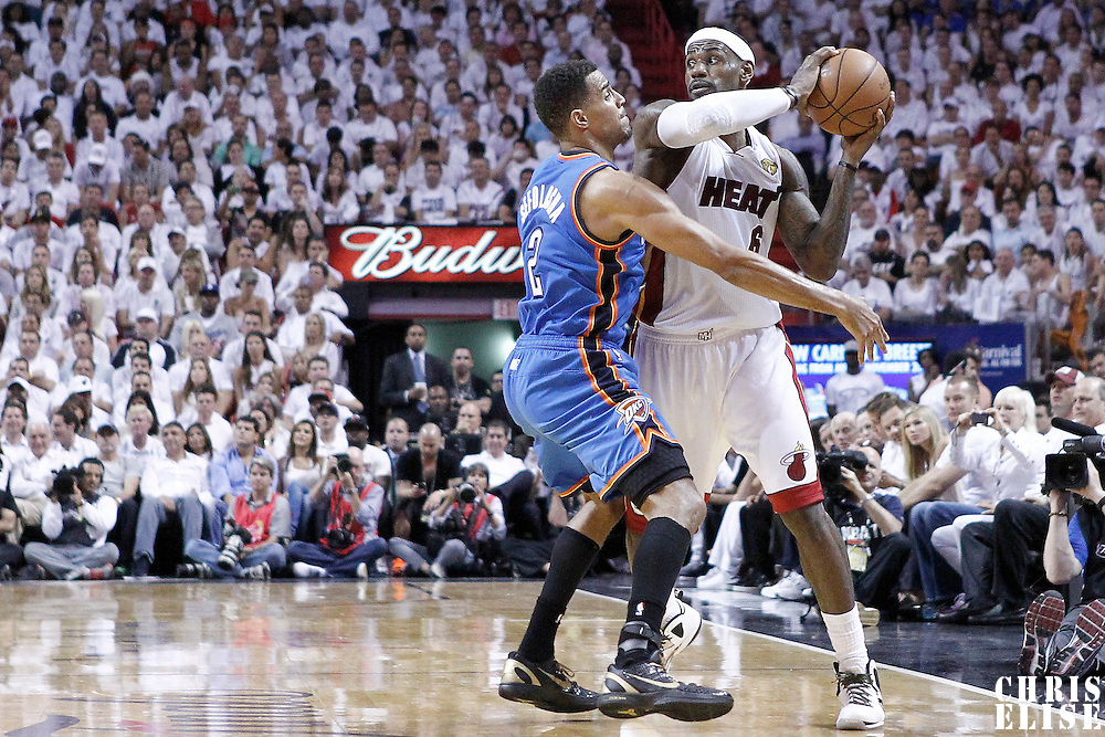 19 June 2012: Miami Heat small forward LeBron James (6) looks to pass the ball past Oklahoma City Thunder shooting guard Thabo Sefolosha (2) during the Miami Heat 104-98 victory over the Oklahoma City Thunder, in Game 4 of the 2012 NBA Finals, at the AmericanAirlinesArena, Miami, Florida, USA.