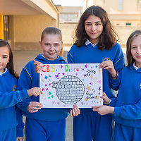 Sophie Cole, Molly Lennon, Alma Griffin and Grace O'Driscoll with a poster for the CBS Disco